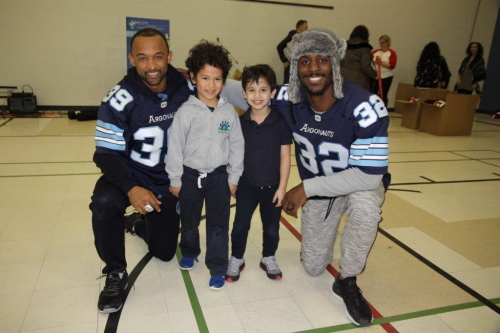 Toronto Argonauts pose with students