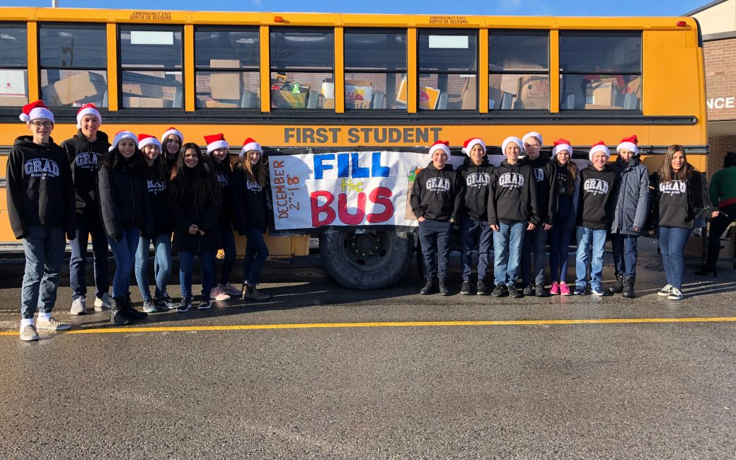 Alexander Kuska students in front of their full bus.