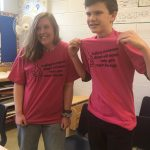 Two students show off their new shirts